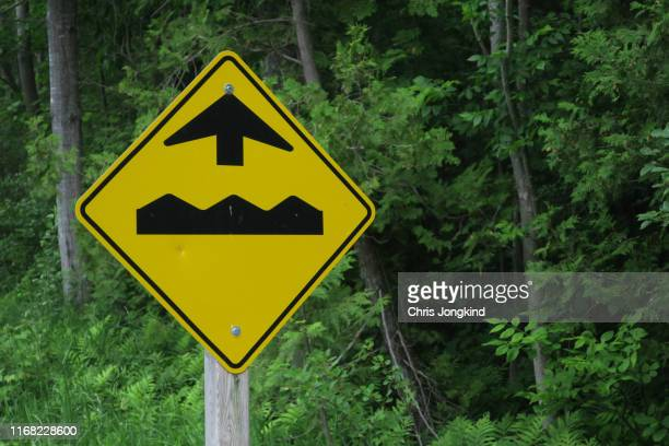bumpy road ahead sign - bumpy stock pictures, royalty-free photos & images