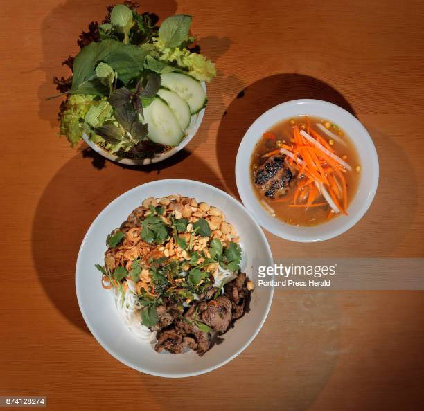 Bun Cha cold vermicelli noodles with caramel pork patties peanuts herbs and a fish sauce for dipping Photographed for Dine Out at Cong Tu Bot in...