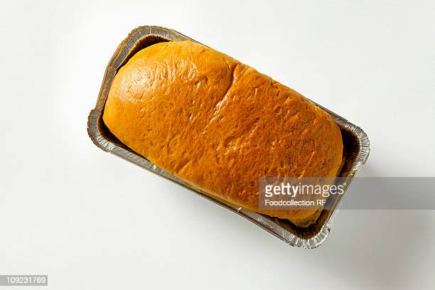 bun in foil tray, close-up - brioche stock pictures, royalty-free photos & images