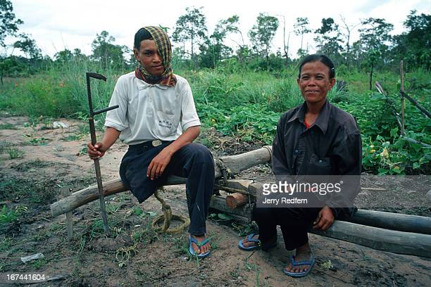 Bun Na and his wife Poeun pose for a photo after arriving on their first day in Veal Thom Bun Na left a life of begging on Phnom Penh's streets to...