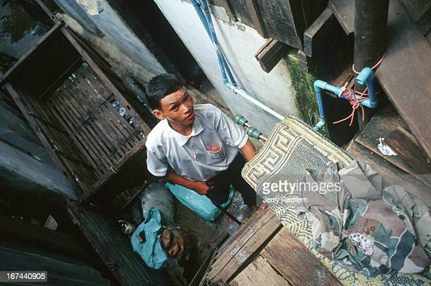 Bun Na removes the last of his possessions from the small airless groundfloor apartment he shared with his wife in Phnom Penh Bun Na left a life of...