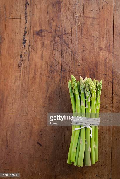 Bunch of asparagus tied with string, still life