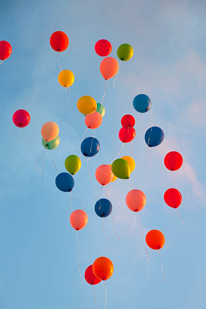 Bunch of balloons floating in sky