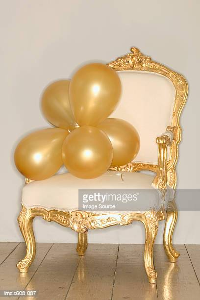 Bunch of balloons on armchair