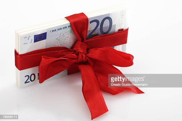 bunch of banknotes tied as gift - twenty euro banknote stock photos and pictures