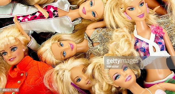 bunch of barbie fashon dolls - barbie stock photos and pictures