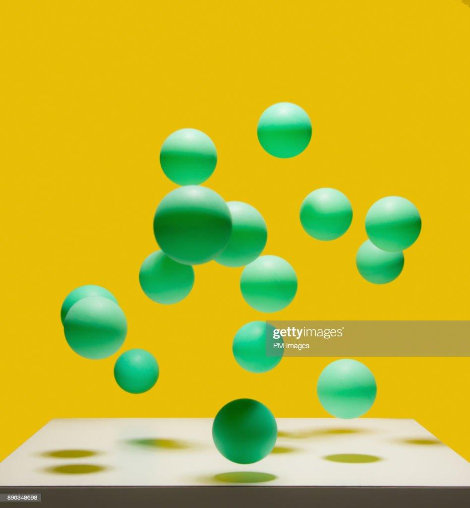 Bunch of bouncing green balls : Stock Photo