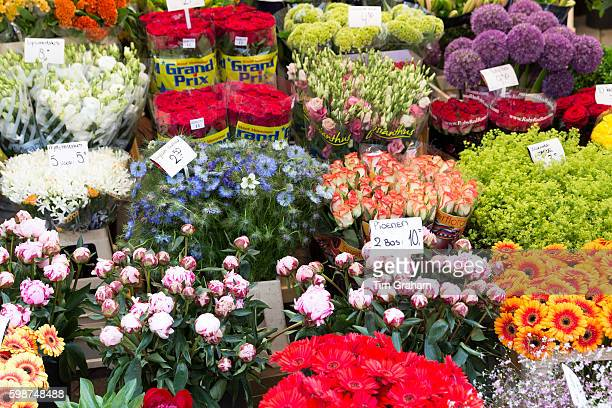 Bunch of bright colour flowers roses peonies gerbera allium at famous flower market Bloemenmarkt in Amsterdam Holland