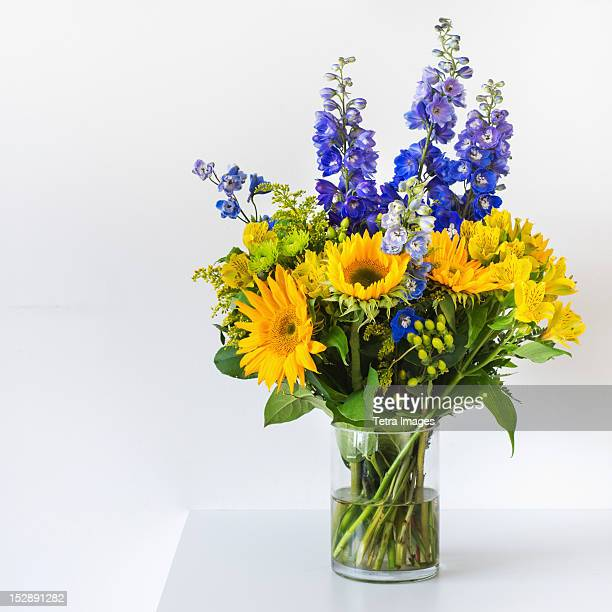 bunch of colorful flowers in vase - bunch of flowers stock pictures, royalty-free photos & images