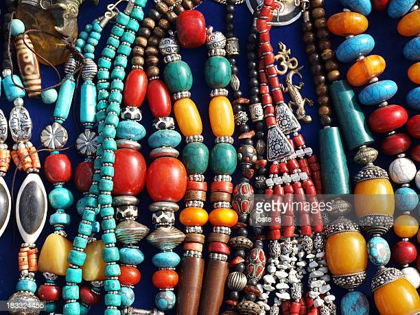 A bunch of colorful street jewelry on a table