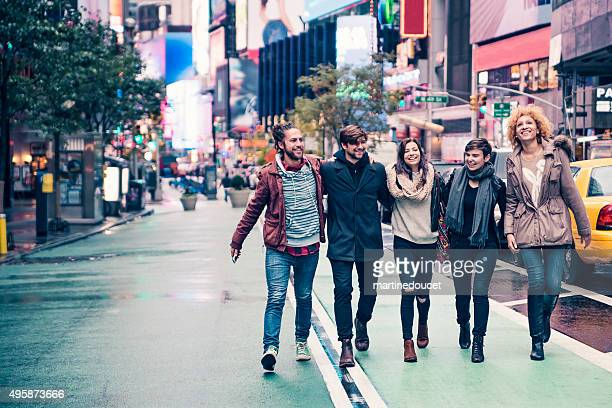 Bunch of cool young people walking in New-York after rain