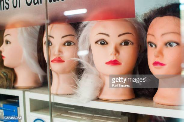 a bunch of female mannequin heads on a store shelf - blow up doll stock pictures, royalty-free photos & images