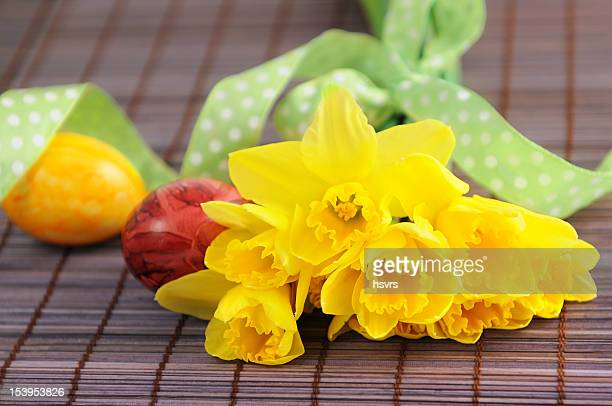 bunch of flower with yellow daffodil and easter eggs - daffodils stock photos and pictures