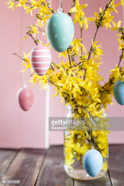 Bunch of Forsythia and colourful Easter eggs