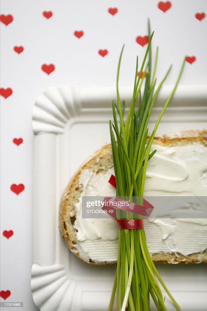 A bunch of fresh chives on a bread with cream cheese : Stock Photo