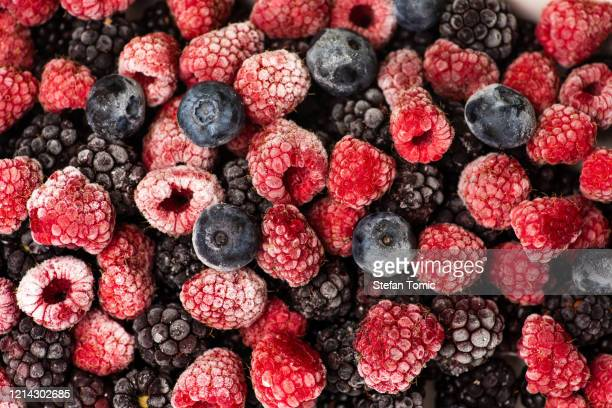 bunch of frozen berry fruit background pattern - berry stock pictures, royalty-free photos & images