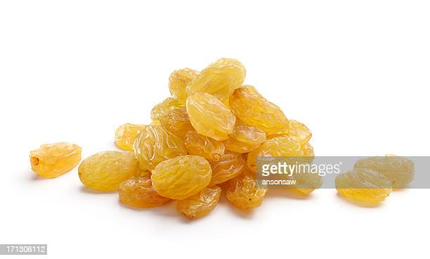 Bunch of golden yellow raisins isolated on white background