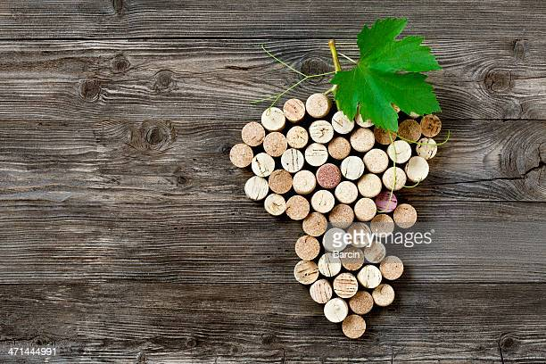 bunch of grapes shape made with corks - cork stopper stock photos and pictures