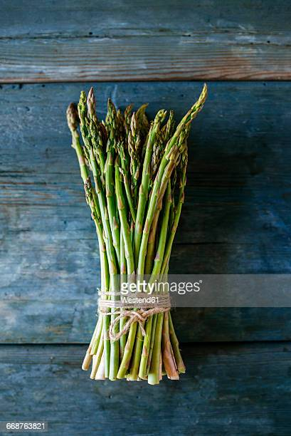 Bunch of green asparagus on wood