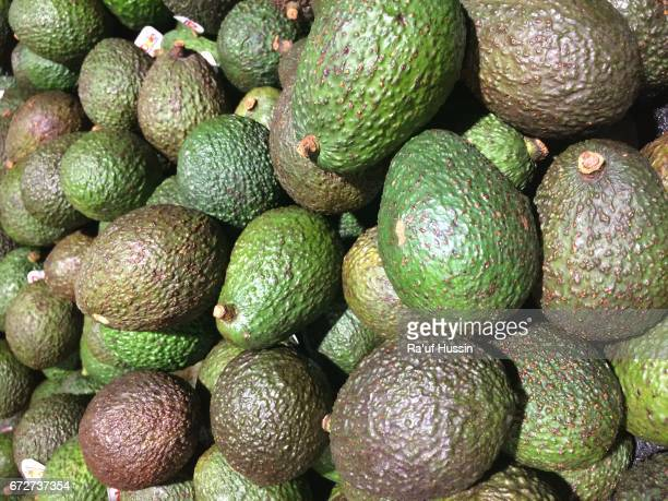 Bunch of green Avocados on display for sale