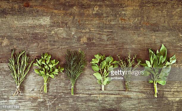 Bunch of herbs on wooden table