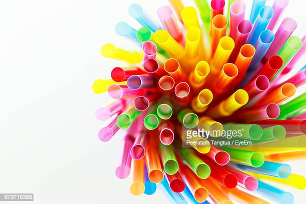 Bunch Of Multi Colored Drinking Straws Against White Background