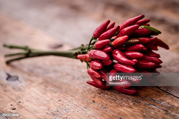 Bunch of red chili peppers on wood