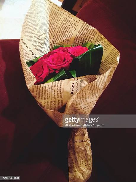 Bunch Of Roses Wrapped In Newspaper