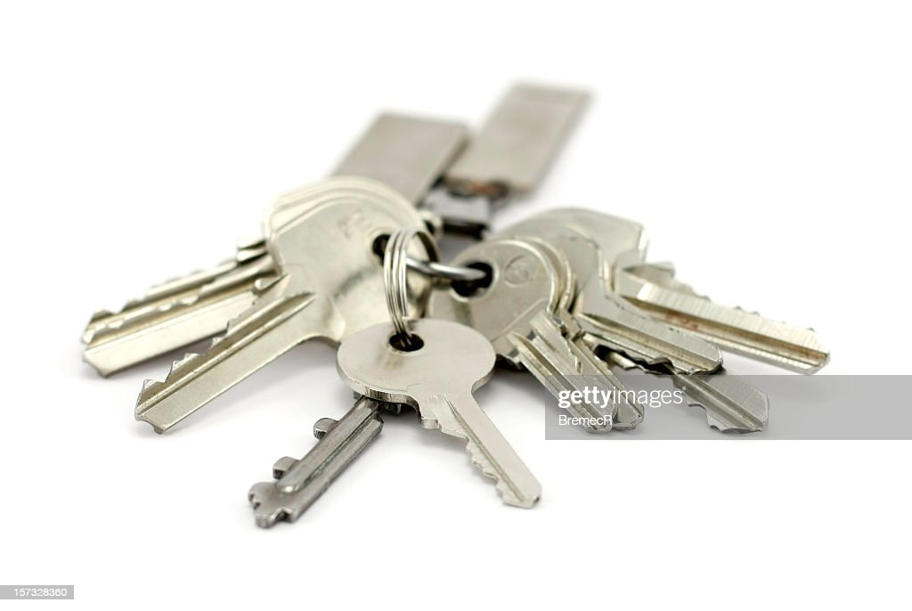 A bunch of silver keys on keychain : Stock Photo