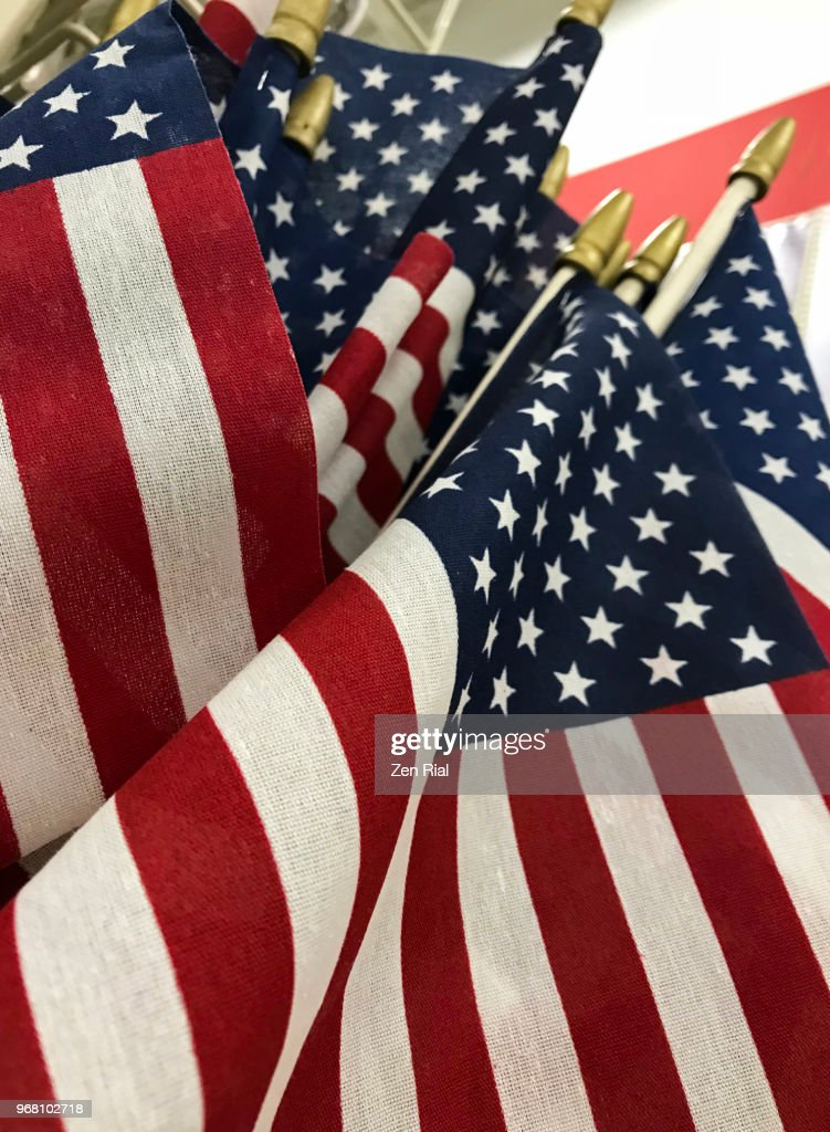 Bunch Of Small American Flags On Display For Sale Stock
