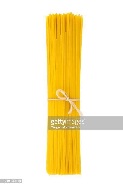 bunch of spaghetti isolated on white background - spaghetti stockfoto's en -beelden