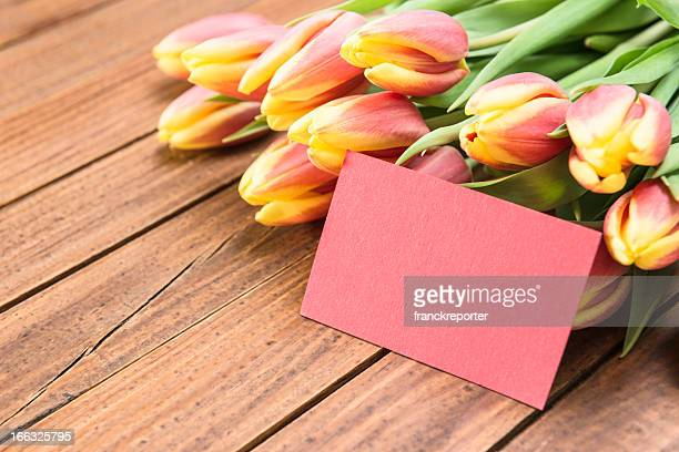 bunch of spring tulips with greetings card