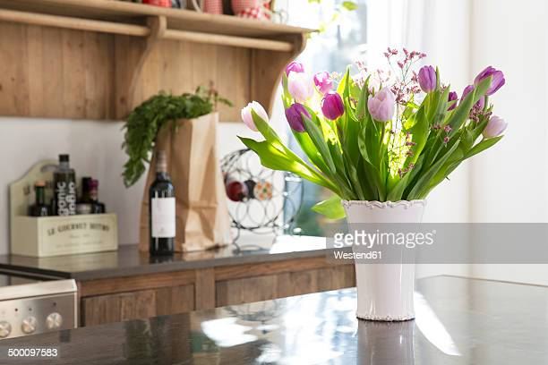 Bunch of tulips on kitchen counter