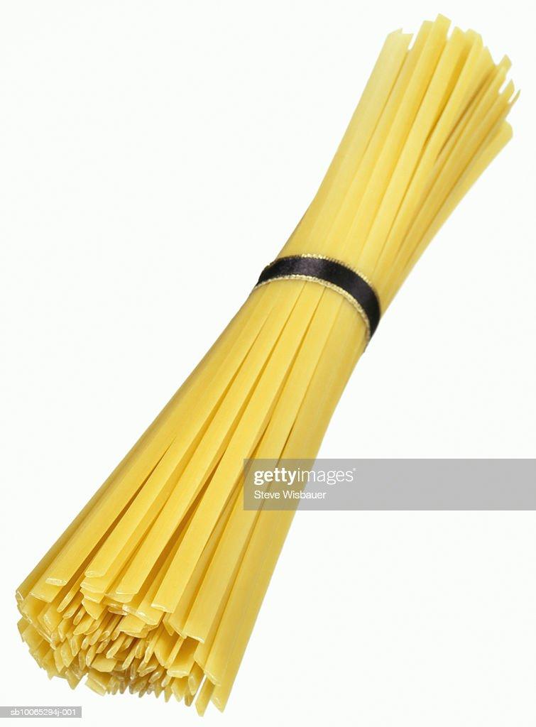 Bunch of uncooked tagliatelle pasta, studio shot, close-up : Foto stock