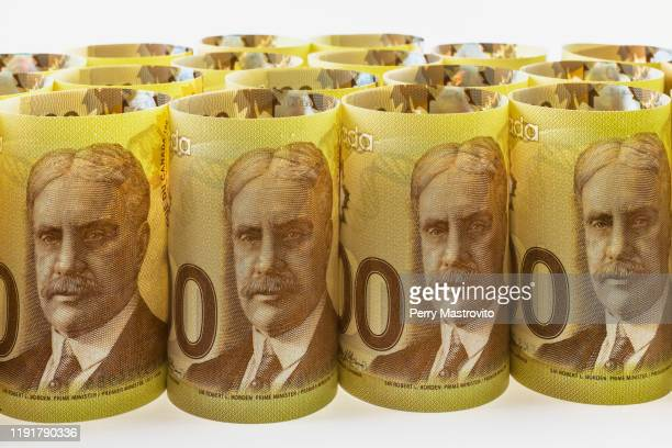 bunch of upright and rolled up canadian one hundred dollar banknotes - canadian one hundred dollar bill stock pictures, royalty-free photos & images