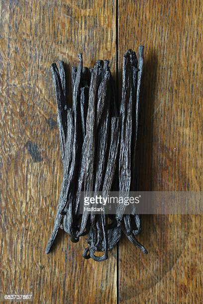 Bunch of vanilla pods on wooden table