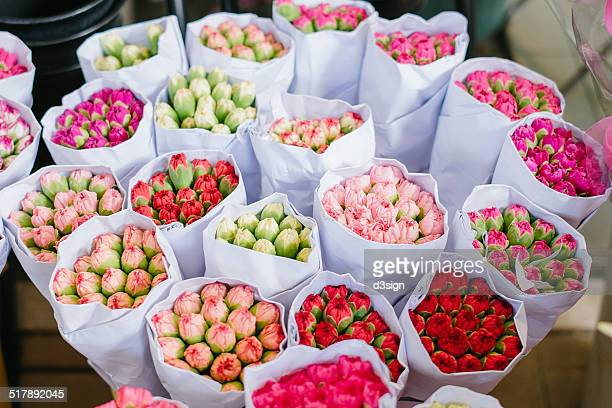 Bunches of colourful Carnations in flower market