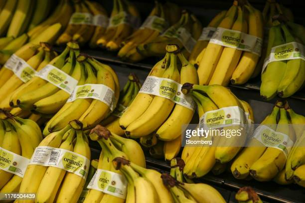 Bunches of organic bananas sit on display in the fresh food section at the newly refurbishedMarks Spencer Group Plc Food shop in London UK on...