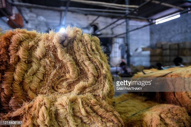 Bunches of vermicelli are stacked in the packing department at a workshop in Ahmedabad on May 23, 2020.