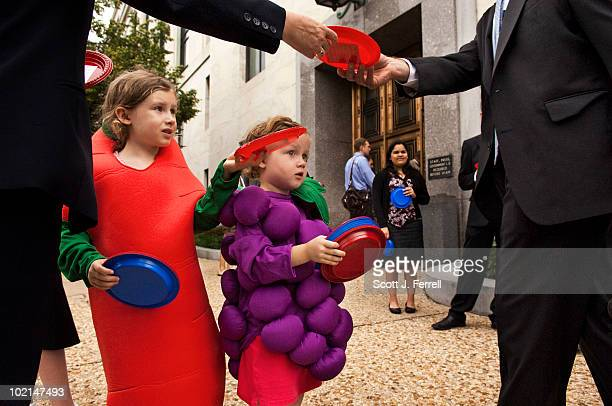 Bunchofgrapes Maden Murray and her sister carrot Davan Murray who just turned 6 pass out plates with a message attached urging timely passage of a...