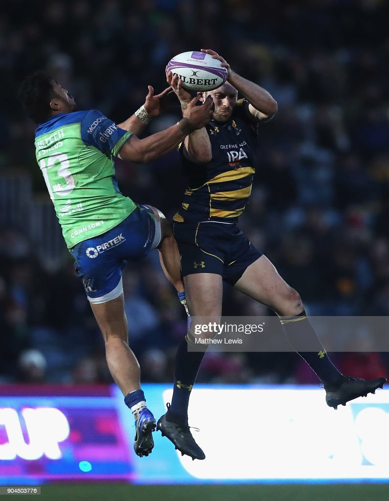 Bundee Aki of Connacht Rugby and Chris Pennell of Worcester Warriors challenge for the ball during the European Rugby Challenge Cup match between Worcester Warriors and Connacht Rugby on January 13, 2018 in Worcester, United Kingdom.