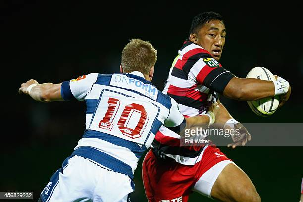 Bundee Aki of Counties is tackled by Gareth Anscombe of Auckland during the round nine ITM Cup match between Counties Manukau and Auckland at...