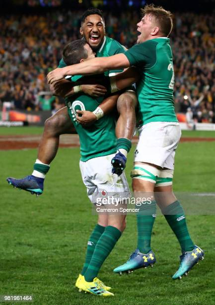 Bundee Aki of Ireland celebrates winning with team mates Johnny Sexton and Jordi Murphy of Ireland during the Third International Test match between...