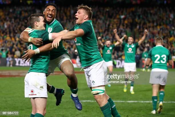 Bundee Aki of Ireland celebrates winning with team mates Johnny Sexton and Jordi Murphy of Ireland during the Third International Test match between...