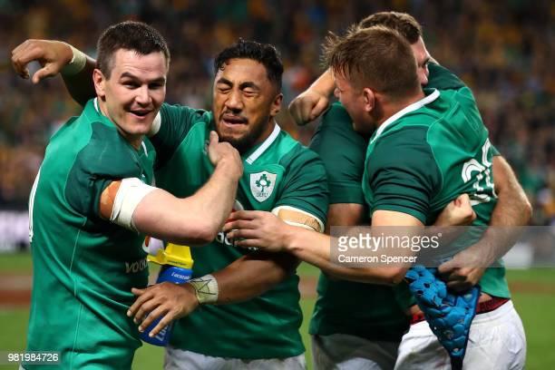 Bundee Aki of Ireland celebrates with Johnny Sexton of Ireland and team mates after winning the Third International Test match between the Australian...