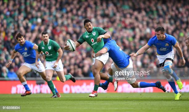 Bundee Aki of Ireland is tackled by Simone Ferrari of Italy during the NatWest Six Nations match between Ireland and Italy at Aviva Stadium on...