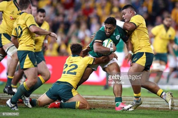 Bundee Aki of Ireland is tackled during the International Test match between the Australian Wallabies and Ireland at Suncorp Stadium on June 9 2018...