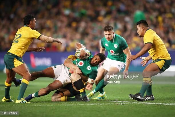 Bundee Aki of Ireland is tackled during the Third International Test match between the Australian Wallabies and Ireland at Allianz Stadium on June 23...