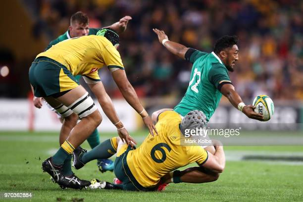 Bundee Aki of Ireland passes as he is tackled during the International Test match between the Australian Wallabies and Ireland at Suncorp Stadium on...