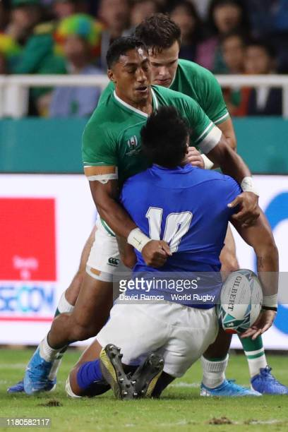 Bundee Aki of Ireland tackles Ulupano Seuteni of Samoa too high which later leads to a red card during the Rugby World Cup 2019 Group A game between...